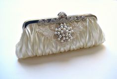 Elegant pleated satin bridal wedding clutch with alencon lace and pearl & crystal jewel.  LACE N PEARLS. $90.00, via Etsy.
