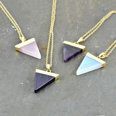Gorgeous semi-precious triangle pendantMake your look very trendy and stylish with this gorgeous semi-precious stone triangle pendant. With a lovely geometric, art deco feel - it's a simple and yet very effective adornment. You can personalise with an initial or add a cute star charm, or both for a compelte look. The star charm is made with stainless steel, a distinct colour from the rest of the necklace to give a little bit different and unique look.Brass in gold plated, Semi-precious and…