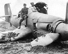 STUKA in emergency landing, with Soviet soldiers admiring (?) their prize.