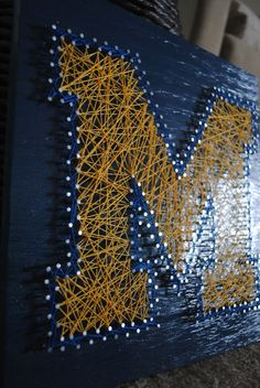 Team Logo- Stained and Finished University of Michigan