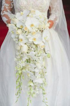 Cascading Bridal Bouquet Which Features: Ivory Roses, White Hyacinth, White Dendrobium Orchids + Buds & White Phalaenopsis Orchids + Buds White Orchid Bouquet, Orchid Bouquet Wedding, Cascading Wedding Bouquets, Cascade Bouquet, Bride Bouquets, Floral Wedding, Wedding Flowers, Wedding Dresses, Purple And Gold Wedding