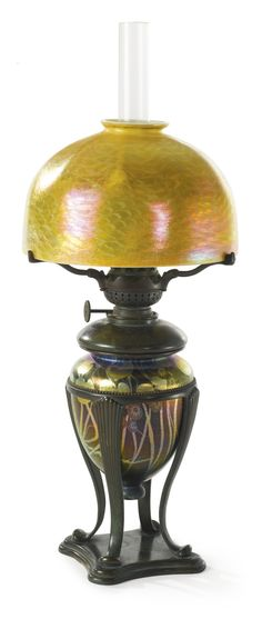 TIFFANY STUDIOS TABLE LAMP shade engraved L.C.T. Favrile font impressed 23641/TIFFANY STUDIOS/NEW YORK and with the Tiffany Glass and Decorating Company monogram base impressed TIFFANY STUDIOS/NEW YORK/23641/6/F.G.R 5581 and with the Tiffany Glass and Decorating Company monogram favrile glass, patinated bronze and with a clear glass chimney 14 5/8  in. (37.1 cm) high (excluding glass chimney) 7 1/8  in. (218.1 cm) diameter of shade circa 1905
