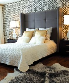 """""""Imperial Trellis,"""" a Kelly Wearstler-designed wallpaper, provides a playful backdrop to an oversize, charcoal bed from Silva outfitted with linens from 18Karat. #bedroom #homedecor #design"""