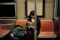 Women Reading - 20aliens: USA. NYC. In a subway. 1996 Harry...