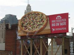 Steaming Pizza Billboard  Creative billboard promotes Donatos pizza in Columbus, USA.    www.toxel.com