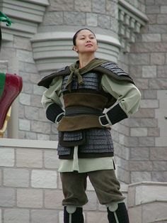 """Can I just say that I think this is the way Mulan should appear int the parks. In the beginning of the movie they make it very clear that the dress she wears to meet the matchmaker is not comfortable nor does it represent her personality. She spends the whole of the film proving that she is not a prize to be won or just a pawn to be married off at earliest convenience. She proves her worth in this outfit. She saves China in this outfit. She falls in love in this outfit. […]"" 