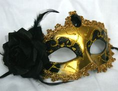 Black and gold masquerade mask in a Venetian style £9.99
