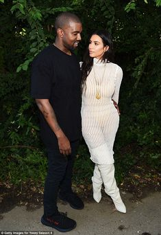 Standing by her man: Kim joined husband Kanye West at his show earlier that day in a racy ...