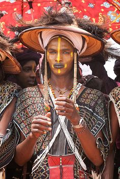 A Wodaabe man at the Gerewol festival, Niger. Again with the unreal textiles.