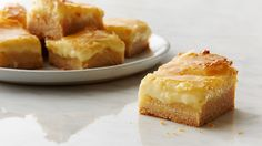 Sweet vanilla cake is topped with a gooey cream cheese layer that's butterlicious, to say the least!