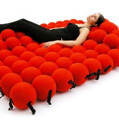 i want!Enjoy an anytime snooze with The Feel Seating System Deluxe. Composed of 120 squishy balls, this oversize piece can be molded into countless positions allowing you to create the chair, lounger or bed of your dreams.