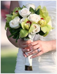 green orchids for wedding bouquets | round bouquet of white roses and green cymbidium orchids. This bouquet ...
