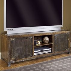 Two-door media console crafted from hand-planed reclaimed wood.   Product: Media consoleConstruction Material: Ma...