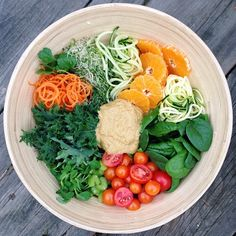 Garden-to-Table Rainbow Salad! Carrots, baby kale, baby spinach, cilantro, tomatoes, alfalfa sprouts, pea shoots, cucumber, zucchini, mandarin oranges, & celery. Dressing was a blended mix of 1/2 medium zucchini, 1/2 red pepper, 1/2 teaspoon paprika, 1/4 cup sesame seeds, 2 scallions, a little bit of leek, 1 large garlic clove, & juice of 1.5 lemons.