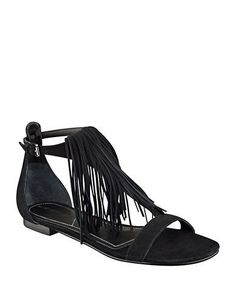 <ul> <li>Stylish T-strap sandals with lively fringe detail</li>  <li>Leather upper</li>  <li>Open toe</li>  <li>Adjustable ankle strap</li>  <li>Fringe trim</li>  <li>Synthetic lining & sole</li>  <li>Lightly padded insole</li>  <li>Imported</li> </ul>