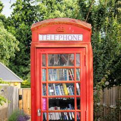spotted just outside of cambridge: a classic red phone booth-turned-mini library