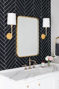 bathroom | black herringbone tile, white cabinets, marble countertop, gold accents