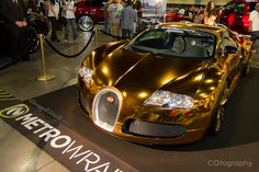 Flo Rida's Gold Wrapped Bugatti Veyron; because nothing says a Bugatti owner is rich like a hideous gold chrome exterior! #LayIt #VinylWraps at www.rvinyl.com/vinyl-wrap.html