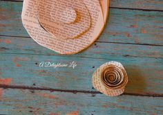 A DELIGHTSOME LIFE book page round and roseThis project took some time. Using hot glue makes you take care...but, the end result is oh, so worth it! LOVED this project - book page rose wreath! See more at A Delightsome Life