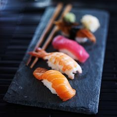 assorted sushi nigiri on slate by Joshua Resnick on 500px
