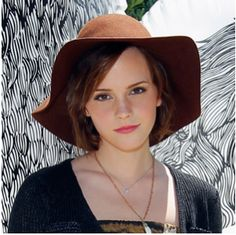 Emma Watson wears a bob and floppy brown hat  Cute summer hats should be on every gals list of summer must-have accessories! Throw on your shades and sandals, splash on a bit of lotion and top off a casual summer do with a fabulous hat . . . and you're golden!
