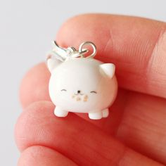 This Neko Atsume Tubbs inspired charm is the perfect accessory to add a touch of cuteness to your life!     It is made out of strong oven bake polymer clay. The eyepin (finding) is secured with super glue to ensure durability.    It was glazed with a high quality gloss varnish for protection and ...