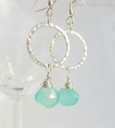 Dainty... but makes a great impact - Aqua chalcedony gemstones hang from silver hammered hoops - Ear wires are sterling silver - Earrings dangle just over 2 Inches - Hoops are approx 3/4 of an inch ac                                                                                                                                                                                 More