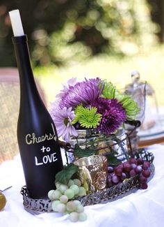 chalkboard paint on a bottle of wine. write message to guests, or use for table numbers. cheap, easy, and classy. LOVE THIS.