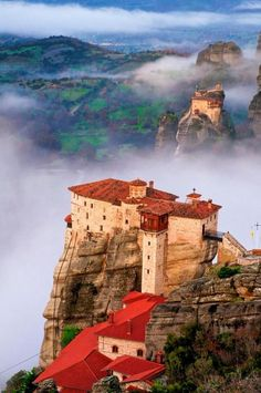 The incredible monasteries of Meteora, Greece, built on majestic sandstone rock pillars. Today an UNESCO World Heritage Site, the name 'meteora' means 'suspended in the air' in Greek. Beautiful Places To Visit, Places To See, Places To Travel, Travel Pics, Vacation Travel, Myconos, Kirchen, Greece Travel, Belle Photo