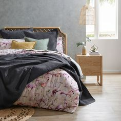Bring a tropical style to your bedroom with the Flamingo Paradise quilt cover. Made from 250 thread count cotton, striking flamingos pose amongst lush greenery for a refreshing style. This quilt cover is finished with a printed reverse and filled piping trim. Coordinate with European pillowcases for a complete style. #quiltcover #duvetcover #doonacover #flamingopattern #tropicaldesign