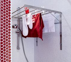 Turn your shower into a laundry room with the GRUNDTAL folding drying rack. It simply folds down out of your way once the laundry is done.