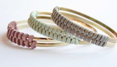 Favorite  Like this item?    Add it to your favorites to revisit it later.  Gold and suede bangle set. Mint suede, herringbone pattern. One matte gold, one bright gold woven together. Stunning design, heavier weight.