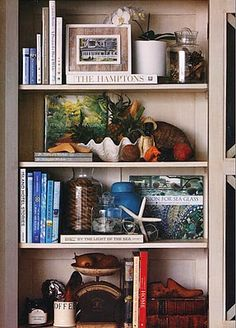 bookshelf styling - eclectic. Like the layers of books and accessories, some three-deep.