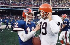 Bernie Kosar Cleveland Browns | Kelly (12) playfully pokes Cleveland Browns quarterbacks Bernie Kosar ...