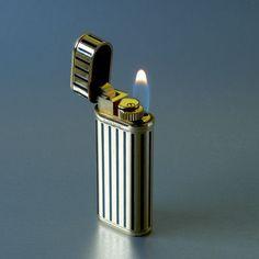 Cartier lighter, limited edition 1847 pcs, vertical black enamel stripes, gold plated, probably vermeil; [SOLD]