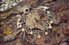 Pretty unique silver plated flower bird feather lotos charm bracelet with rondelle beads