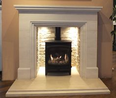 The new Calvi with its slate tile chamber is a fantastic and simple fireplace that is designed to go with any scenario, modern or traditional. Carved from solid limestone Calvi is taller than most fireplaces making it stand out. Log Burner Living Room, Log Burner Fireplace, Limestone Fireplace, Home Fireplace, Fireplace Inserts, Fireplace Surrounds, Fireplace Design, My Living Room, Wood Burner