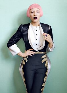 Gaga. Alexander McQueen slash-shoulder tailcoat, bib bodysuit, and embroidered trousers. De Grisogono ring.