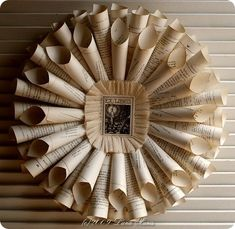 book pages wreath - this would look great with a mirror in the middle as a different twist the oh-so-trendy sunburst mirror