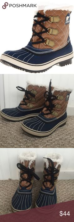 Sorel Women's Tivoli Short Boot Excellent used condition.  * Keep feet warm in below freezing temp * Faux cream colored shearling  * Tan quilted upper, blue rubber lower which is 100% water proof * Run's small   Comes from a smoke free home. Same day shipping on all orders!  Sorel Shoes Winter & Rain Boots