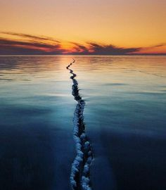 . World In Half By.  Photography by @ (Alexey Trofimov). This photo was taken in February 2015 on Lake Baikal. In ety photo expedition goal was to show the Baikal ice particular and unusual. #baikal#sunrise#baikalice#icecrack#icesunrise