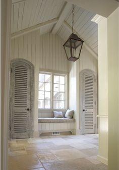 built in window seat, shutters, stone floor, beamed vaulted ceiling