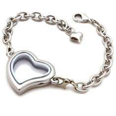 A stunning silver bracelet with a heart shaped locket finished with chain The pendant can be personalised with charms Charms are sold seperately