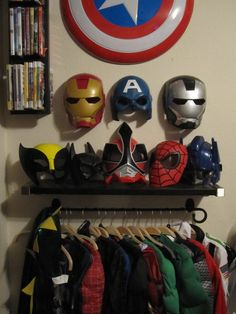 Dress up spot in bedroom. Just a towel bar and shelf (and a box underneath to store other pieces). A perfect superhero addition to his lair :)