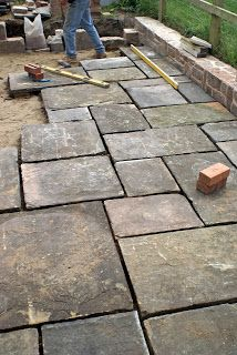 Flagstone paving for the driveway, the turning circle and outside the kitchen.  Already changed my mind - not for the driveway ... we would obviously try and source a creamier-coloured paving stone for you so that it matches the gravel.