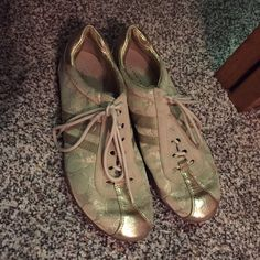Coach tennis shoes (gold) Barley used. Like new. Coach Shoes Athletic Shoes