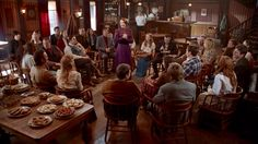 2.03- The saloon now hosting a town meeting, to raise money for the church.  We assume Jack's reward money will cover the building, but Florence mentioned using this money for Bibles, hymnals, and choir robes.