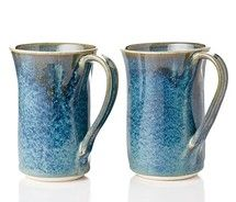 I normally don't like blue mugs, but these are beautiful. The handles are nicely done as well.