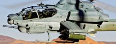 AH-1Z flies over desert terrain. Orlando September 4,2015 - U.S. Army and U.S. Navy awarded Lockheed Martin $66.3 million contract for Engineering and Manufacturing Development (EMD) phase of Joint Air-to-Ground Missile (JAGM) program.24-month EMD phase will include JAGM production, test qualification and integration on AH-64 Apache and AH-1Z Cobra attack helicopters.EMD phase also establishes initial low-rate manufacturing capability in support of 2 follow-on low-rate initial production…