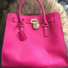 Authentic Michael Kors Purse! Deep, hot pink purse from Michael Kors. There are no stains or markings on the bag. In excellent condition! Only used once.   Will be gone from Dec 20-27th for the holidays! Will ship until Dec 19th and start back up on Dec 28th Michael Kors Bags Shoulder Bags